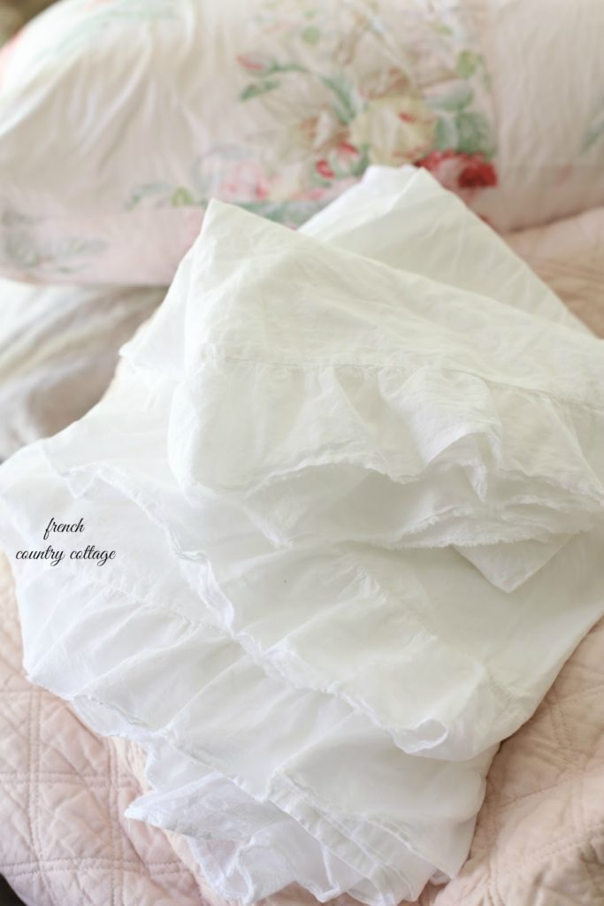 ruffled linen sheets on blush colored quilt