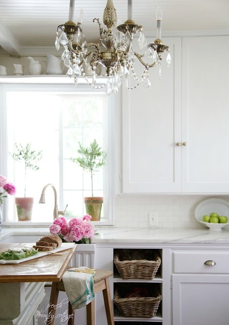 kitchen with chandelier and white cupboards