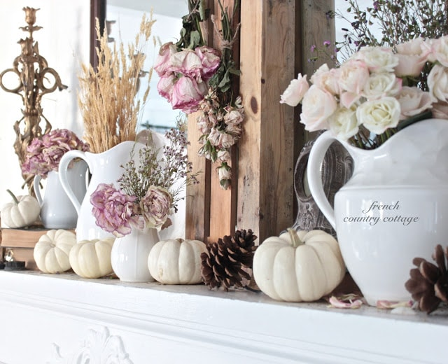 fall mantel with dried roses
