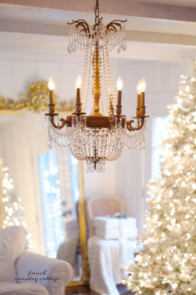 Crystal chandelier with gold mirror and Christmas tree