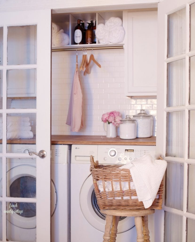 Vintage style laundry room renovation with french doors, butcher block