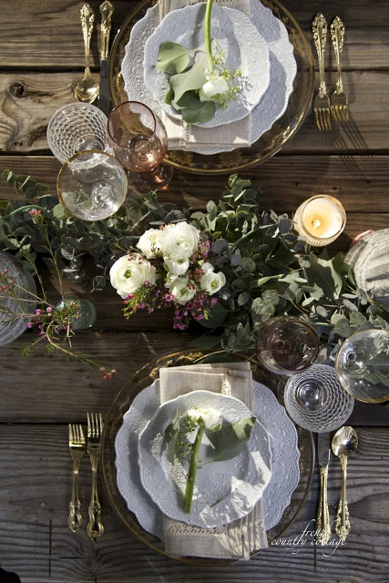 elegant table setting with flowers and blue dishes