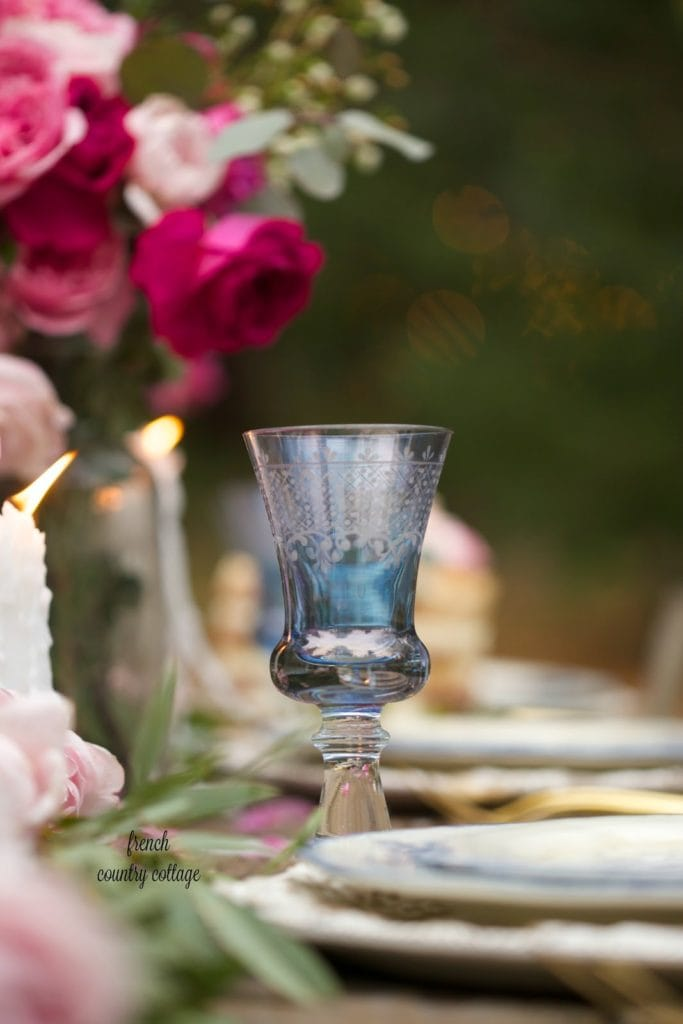 Blue etched wine stem in romantic inspired table setting
