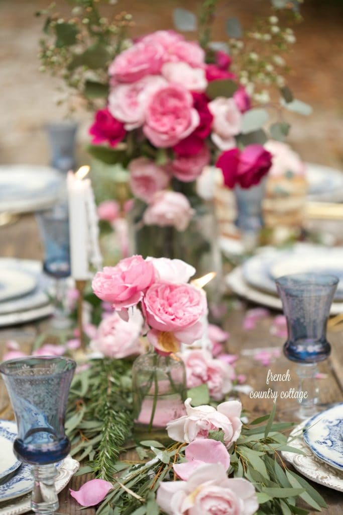 Table setting with blue and white and blush roses for Valentine's day