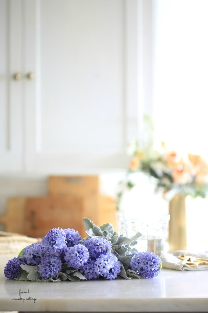 white kitchen with hyacinth flowers