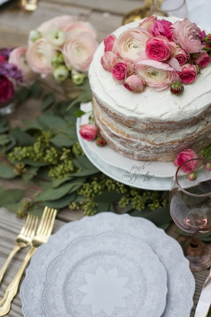 Frosted rustic cake with peonies and roses