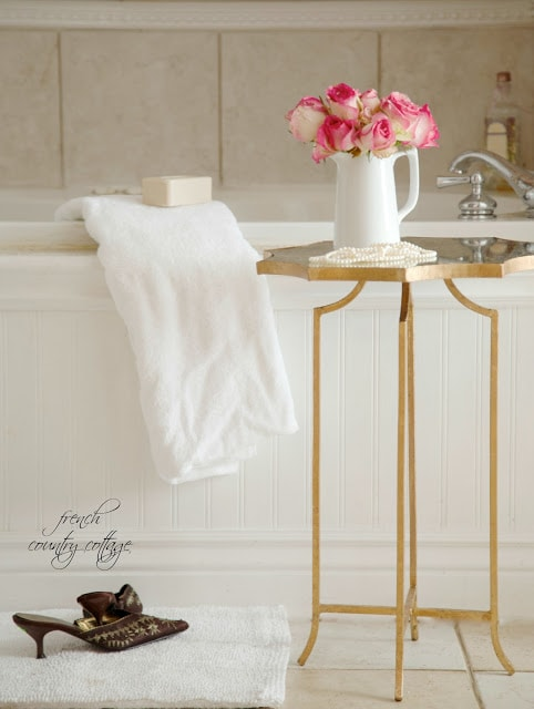 gold table with flowers in bathroom