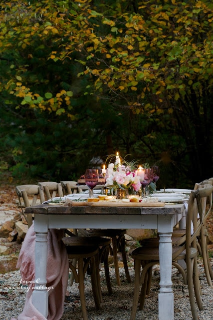 purple and pink outdoor table set under the stars