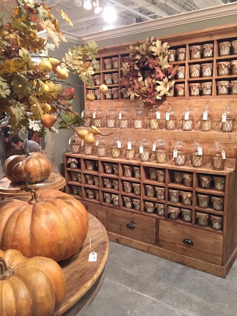 Vintage display cupboard with baskets and glasses with candles