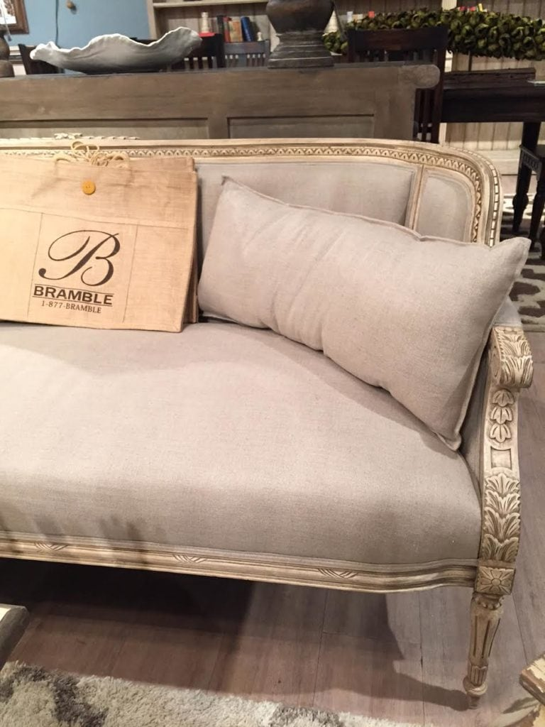 Simple carved sofa with linen fabric and details