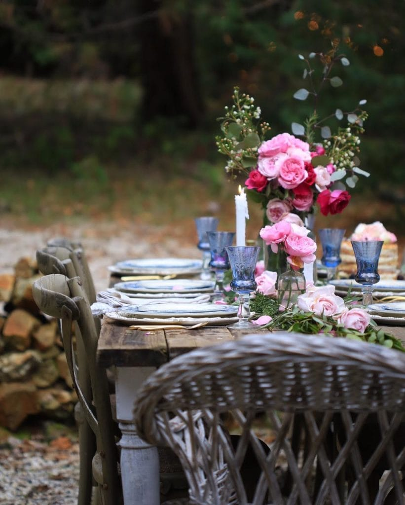 Romantic blue and white and pink table setting for Valentines day