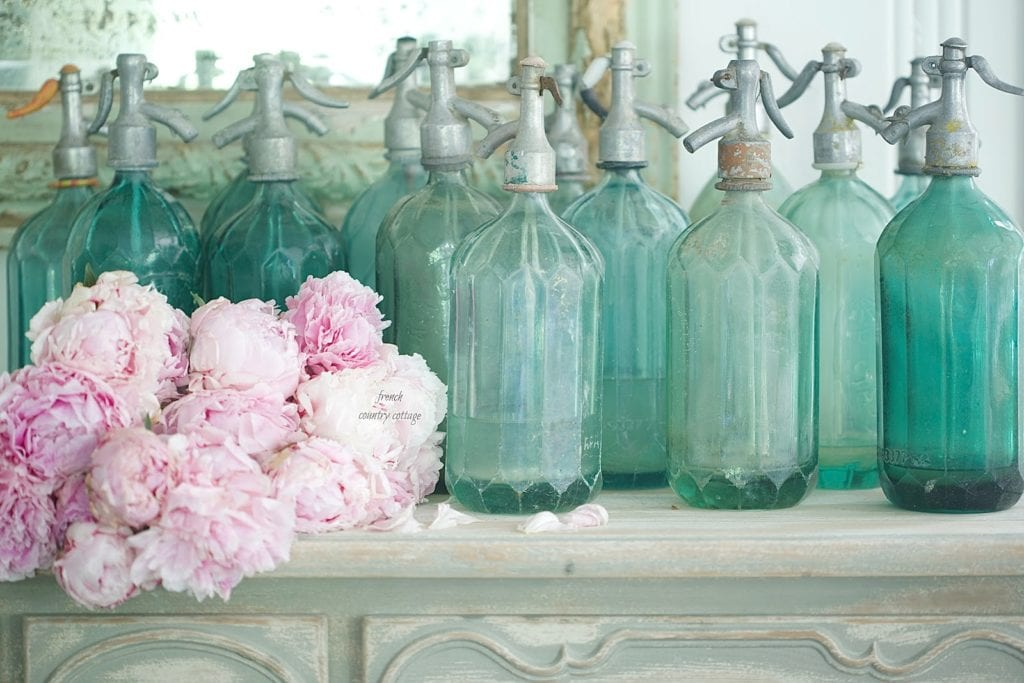 antique and vintage seltzer bottle display