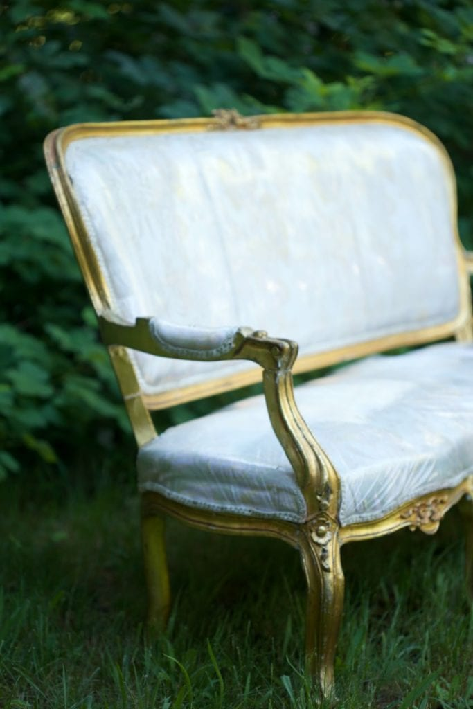 french settee covered in plastic before