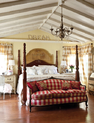 red checked sofa in french country cottage bedroom