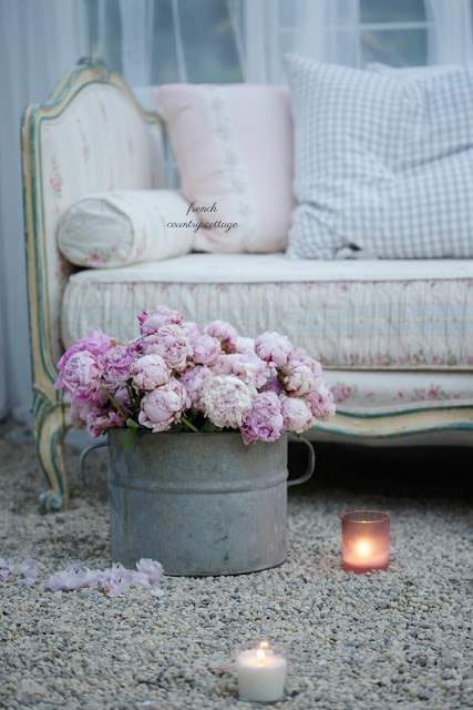 candles and bucket of flowers