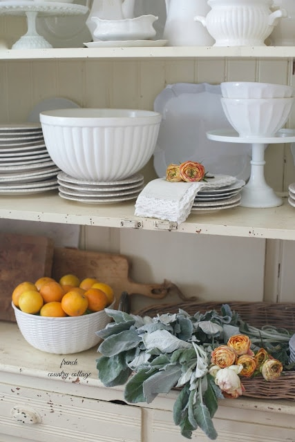 white dishes in cupboard