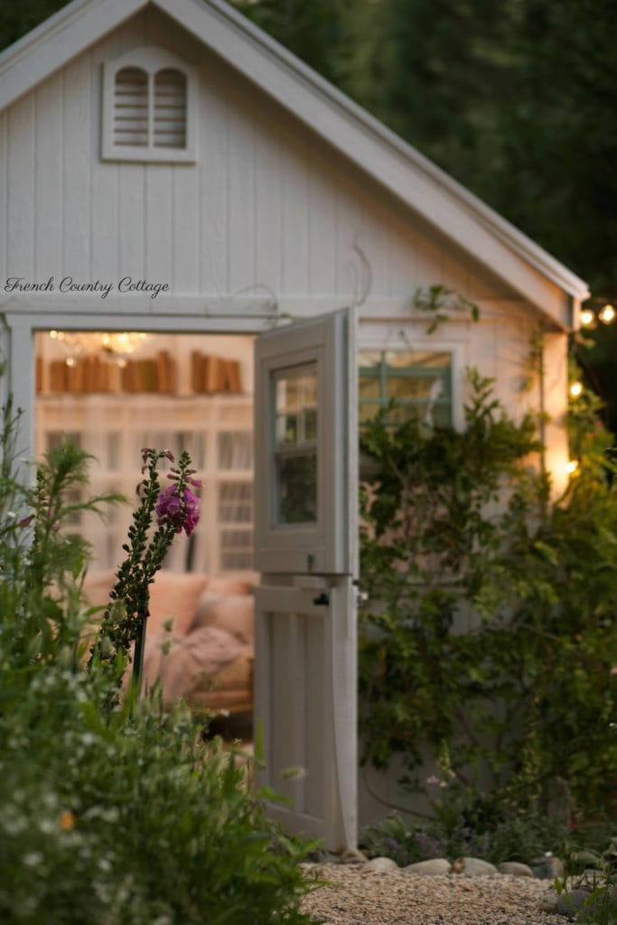 chandelier and twinkle lights at night in she shed