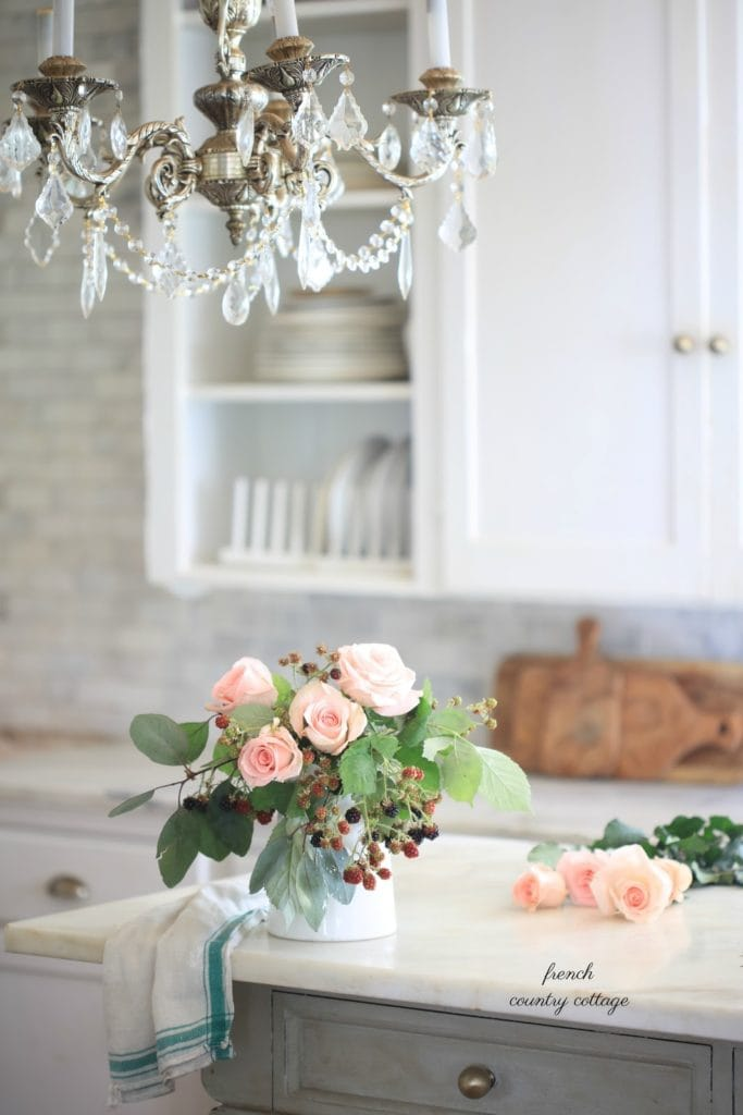 berry and flower bouquet in kitchen