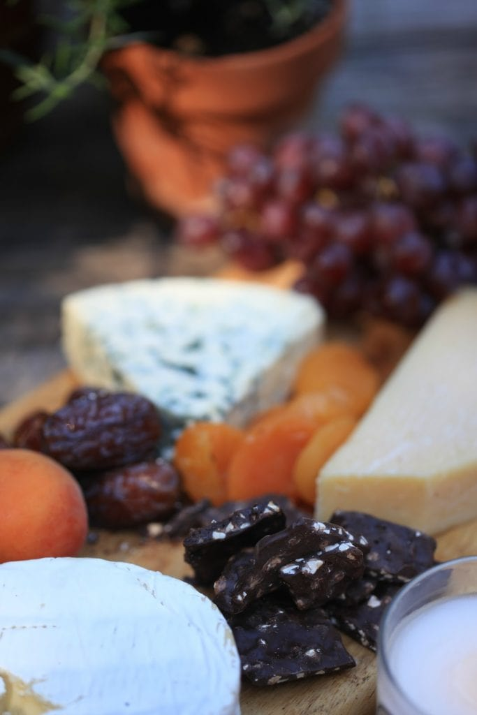 brie cheese and chocolate on cheese board