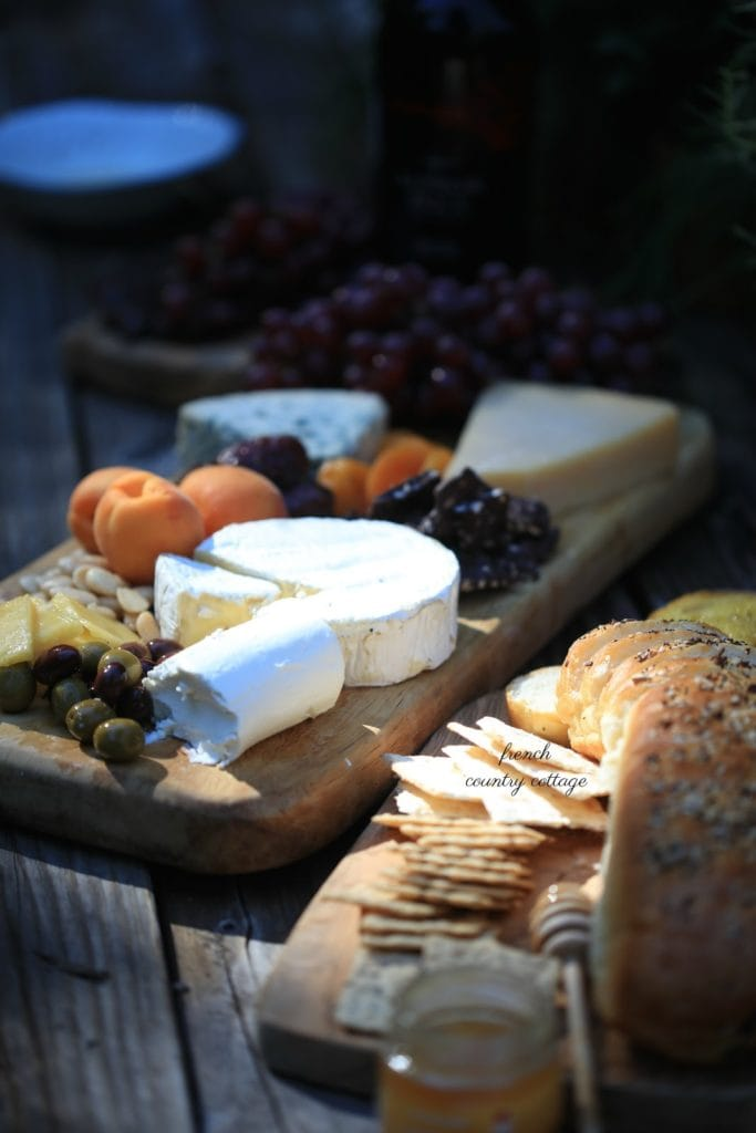 cheeses and breads on a board