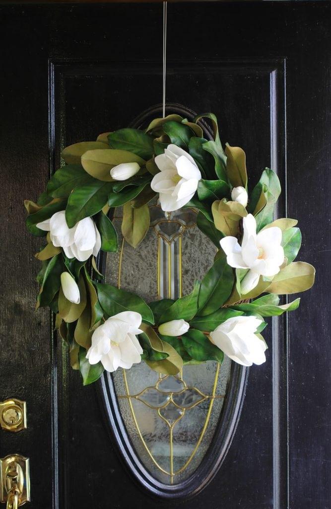 magnolia wreath on front door