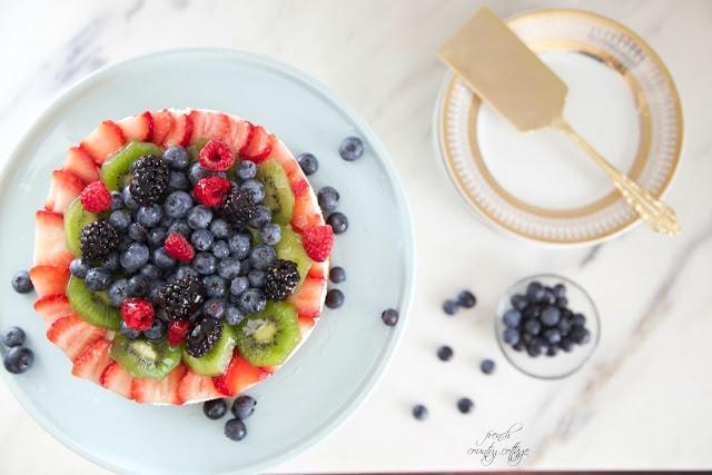 berries and kiwi on dessert cake