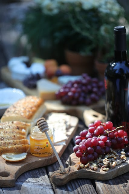 Cheese board with bread and fruit and honey