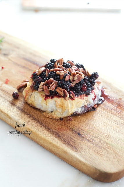 Baked Brie in croute topped with blackberries and pecans