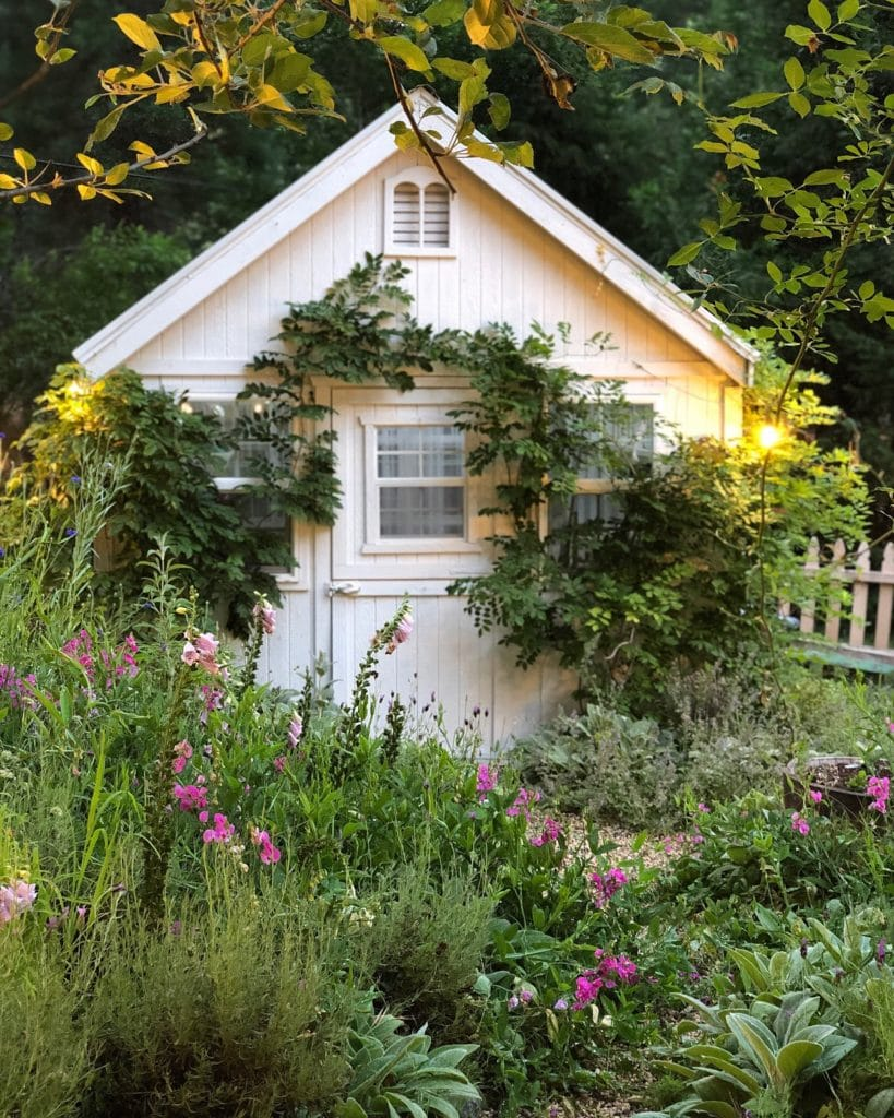 Greenhouse and cottage garden at French Country Cottage
