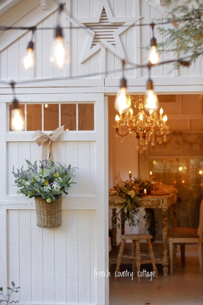 Barn with chandelier and flower basket on door