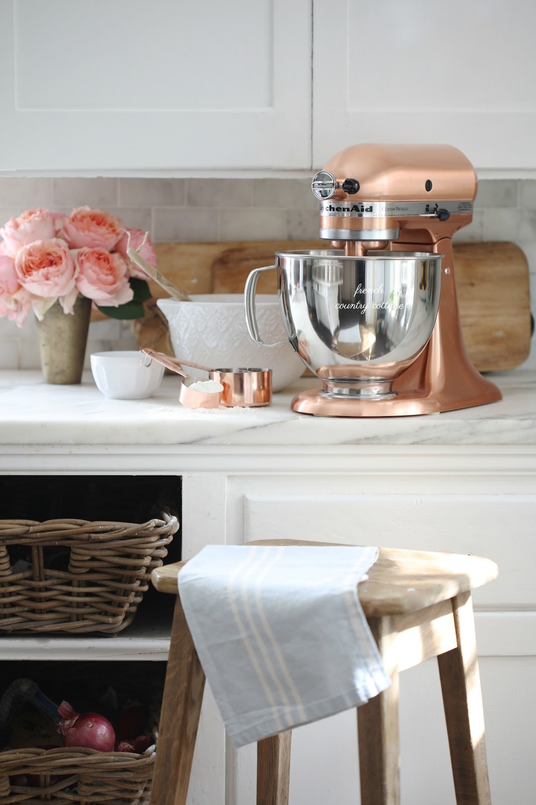 Copper mixer on marble counter
