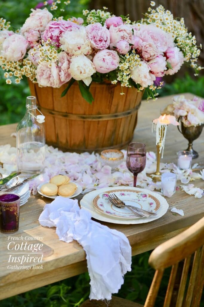 close up of farmhouse table with peonies