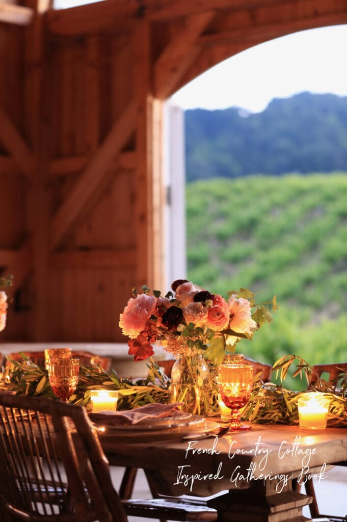 Evening table setting in a vineyard- French Country Cottage Inspired Gatherings
