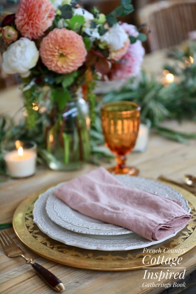 Close up of dishes on table French Country Cottage Inspired Gatherings book