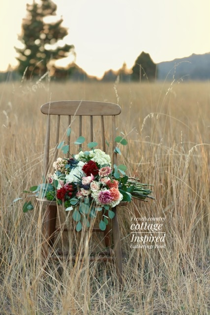 Chair with flowers in a field from Inspired Gatherings Book
