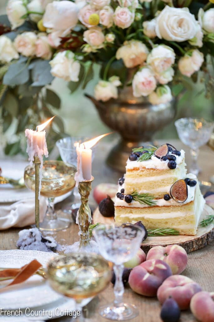 Inspired Gatherings book cover shoot with roses, lemon cake and fruit
