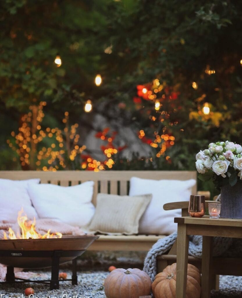 fire pit seating area with twinkle trees in the background