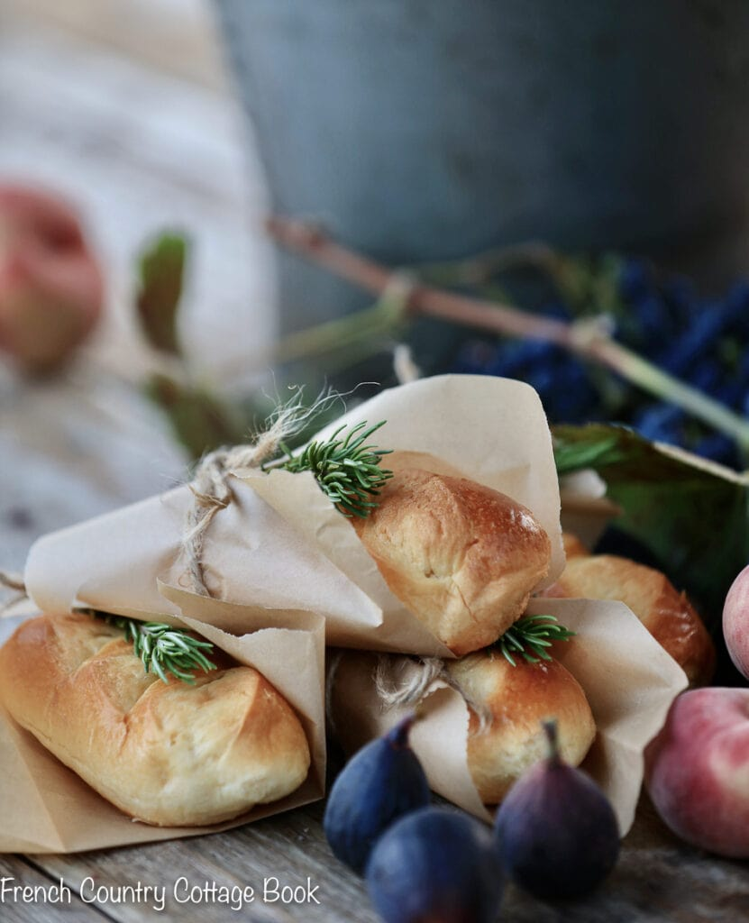 Bread wrapped in paper with rosemary