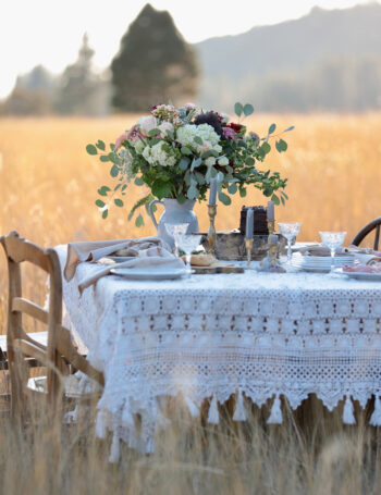 Inspired Gatherings Book Table in a field