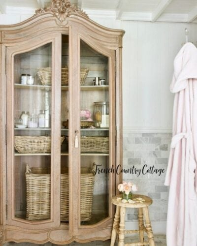 French armoire in bathroom