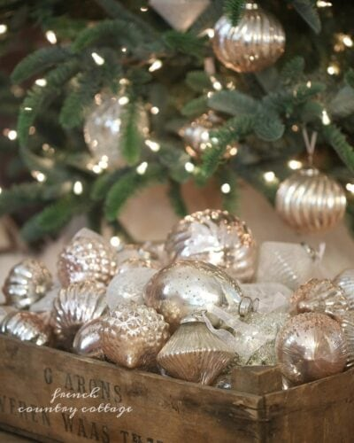 Christmas ornaments inside a wood crate