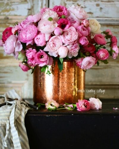Copper pot with peonies and ranunculus