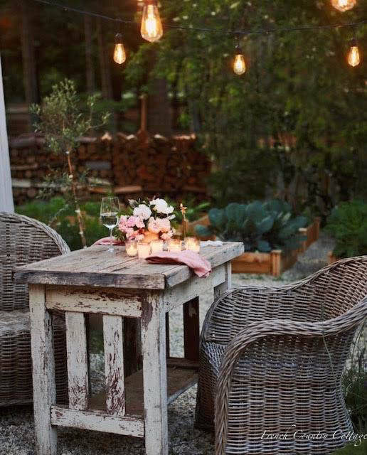 table set for dinner with candles in the vegetable garden