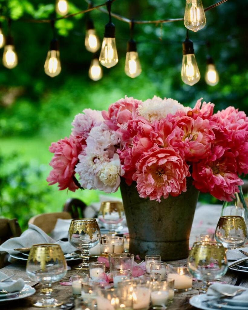 Peonies in bucket on table