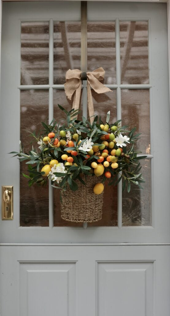 faux floral arrangement on the door