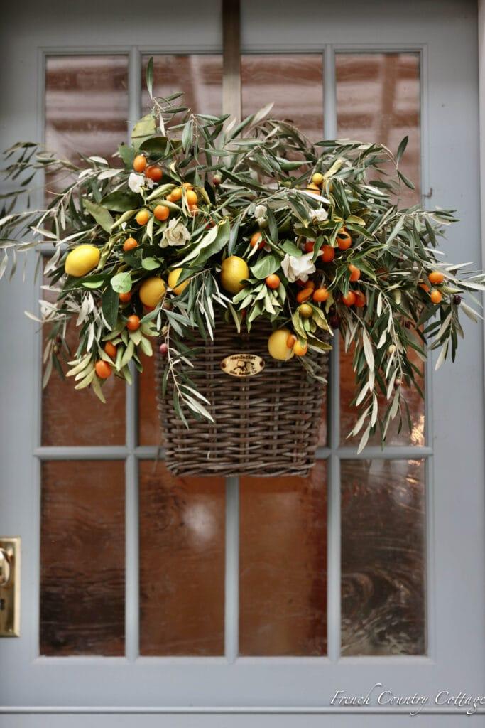 Lemons, kumquats and olive door basket