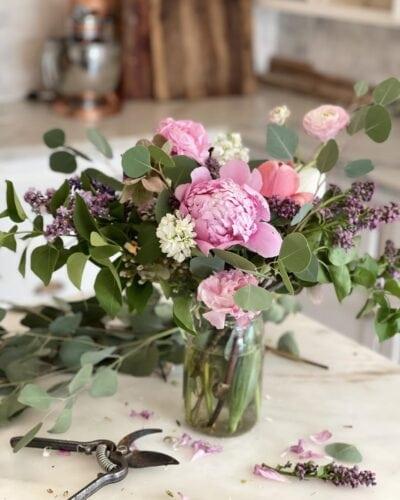 Peony and flower arrangement in kitchen