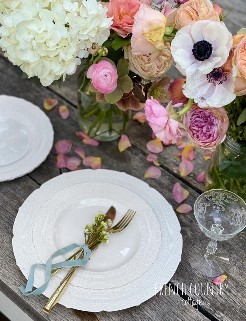 Lace plates on table with flowers