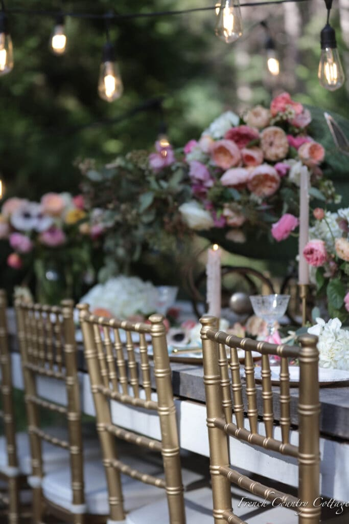 Gold chairs at outdoor dining table