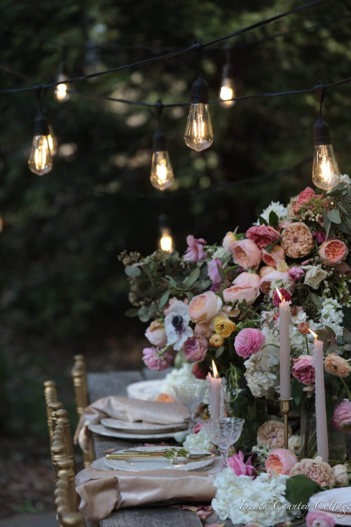 gold chairs and flowers for baby shower dining table